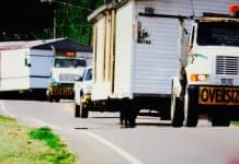 Rhoden case, trucks take homes on highway.