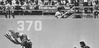 rick monday snatches the US flag from protesters at dodger stadium.