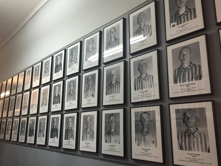 Auschwitz I - Bloc 7 rows of found prisoners' photos on display, time of arrival and time of death.