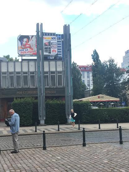 The reconstruction bridge poles the entrance to the ghetto.