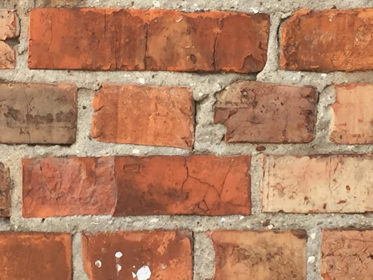 The wall made of authentic bricks from the rubble of the ghetto wall.
