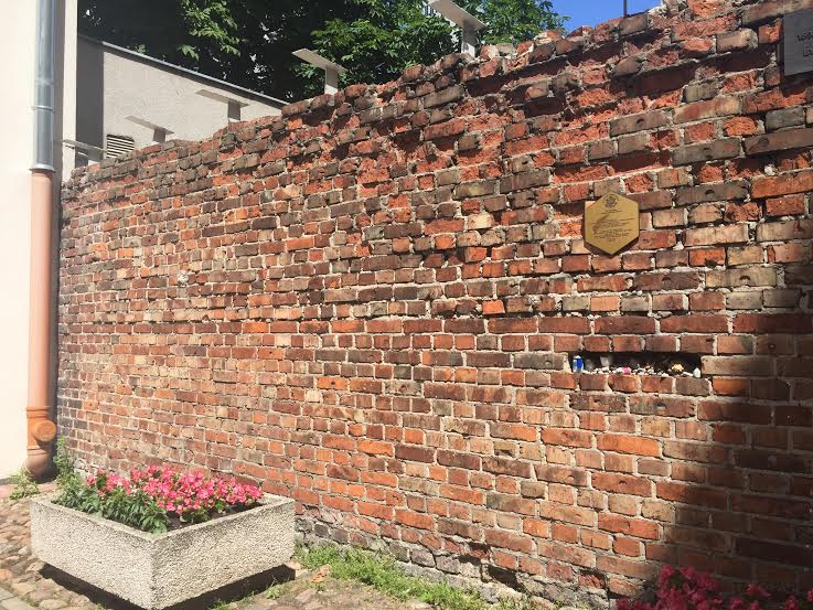 The wall made of authentic bricks from the rubble of the wall.