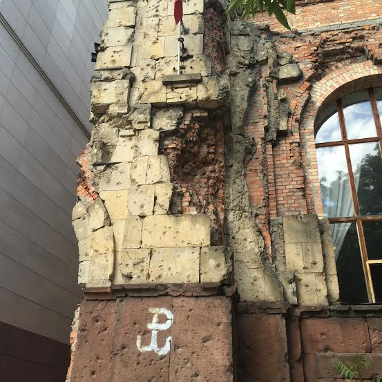 Warsaw-a bulding with a symbol of resistance left authentic and repaired where destroyed