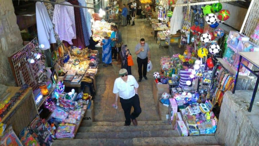 walking through an East Jerusalem market.