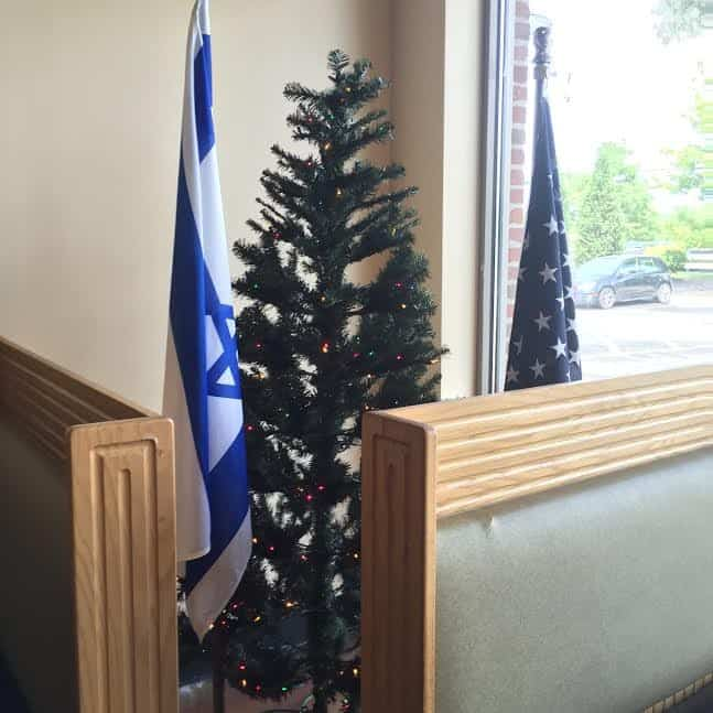 Israel and USA flags in the restaurant's window