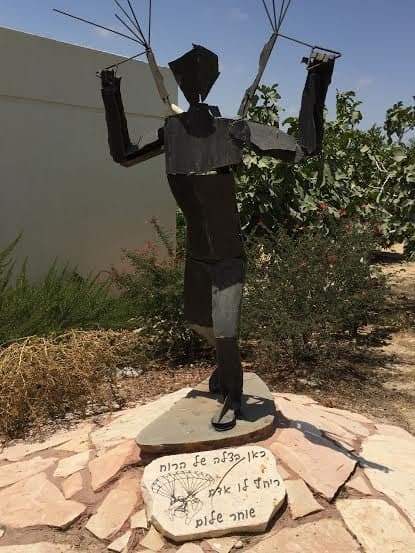 A memorial for Kibbutz member who was working in his garden when the mortar hit and killed him.