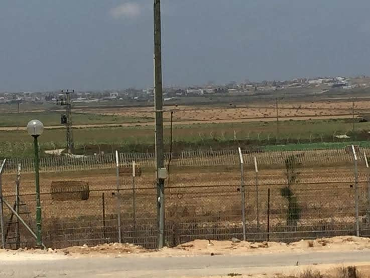 Photo of Shuja'iyya, Gaza, taken from the Israel side of the border, a sophisticated fence surrounding kibbutz Kfar Aza.