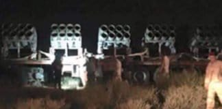 missile launchers on flatbed truck.