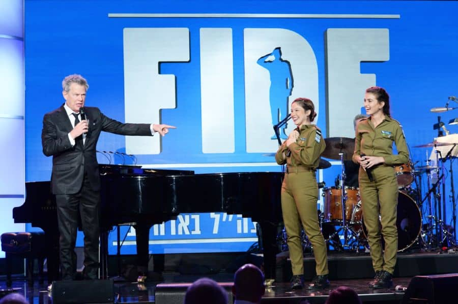 David Foster with two of the Israeli soldiers guests performing