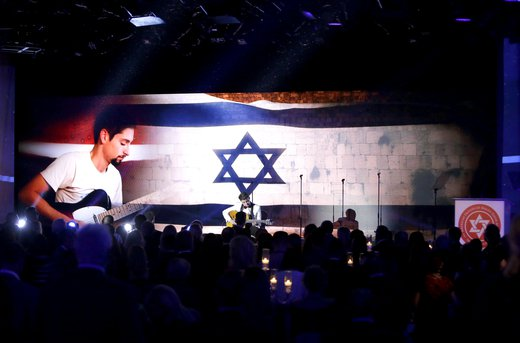 Israel National Anthem, Ha'tikvah' played by two young men, with strong emotional connection, one donated an ambulance the other saved by that ambulance
