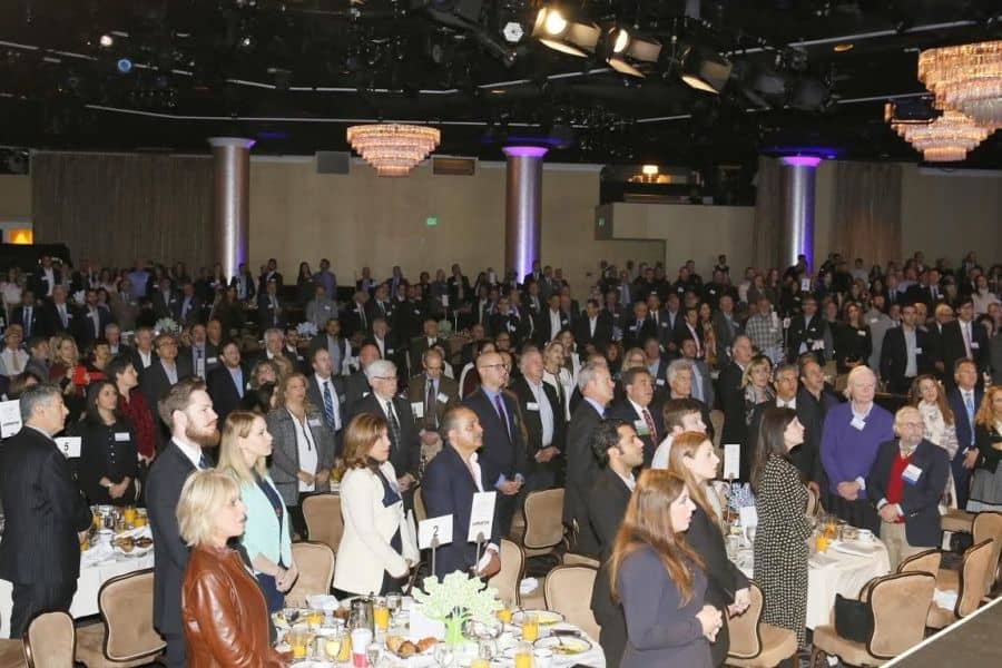 Attendees on their feet for the USA and Israel anthems-Photo Orly Halevy