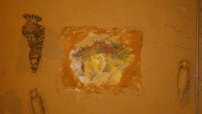 painting carved into wall.