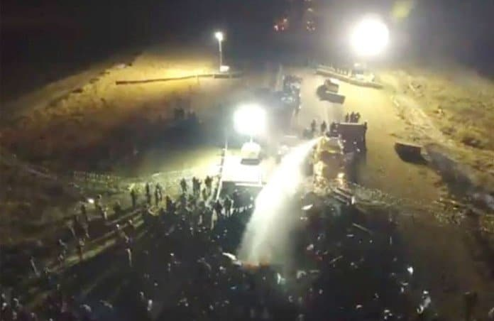 water cannon used on nodapl protestors.