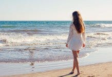 young woman on the beach.