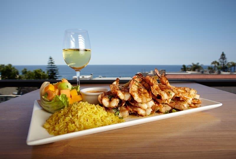 peri peri prawns and wine daylight veranda.