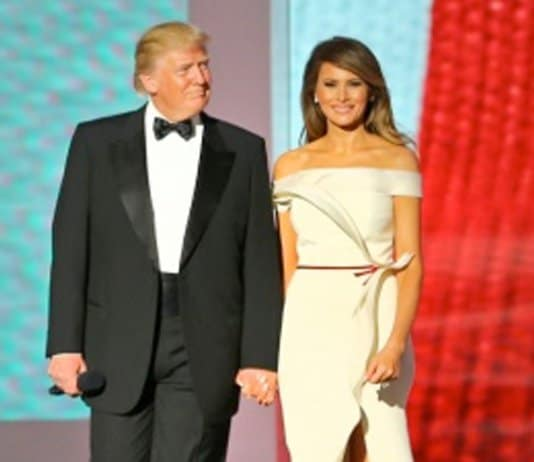 """President Donald J. Trump arrives at the Liberty Ball while the U.S. Air Force Band plays """"Hail to the Chief"""" at the Walter E. Washington Convention Center, Washington, D.C., Jan. 20, 2017. More than 5,000 military members from across all branches of the armed forces of the United States, including Reserve and National Guard components, provide ceremonial support and Defense Support of Civil Authorities during the inaugural period. Melania Trump wears an off-the-shoulder gown by Hervé Pierre. (DoD photo by U.S. Army Sgt. Ashley Marble)"""