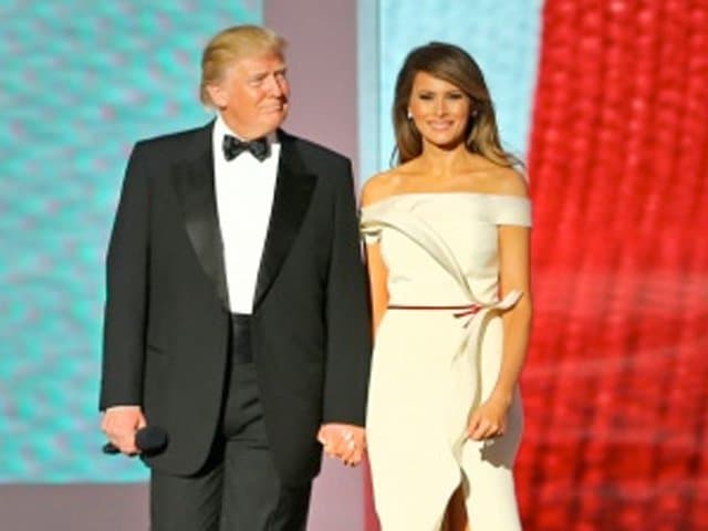 "President Donald J. Trump arrives at the Liberty Ball while the U.S. Air Force Band plays ""Hail to the Chief"" at the Walter E. Washington Convention Center, Washington, D.C., Jan. 20, 2017. More than 5,000 military members from across all branches of the armed forces of the United States, including Reserve and National Guard components, provide ceremonial support and Defense Support of Civil Authorities during the inaugural period. Melania Trump wears an off-the-shoulder gown by Hervé Pierre. (DoD photo by U.S. Army Sgt. Ashley Marble)"