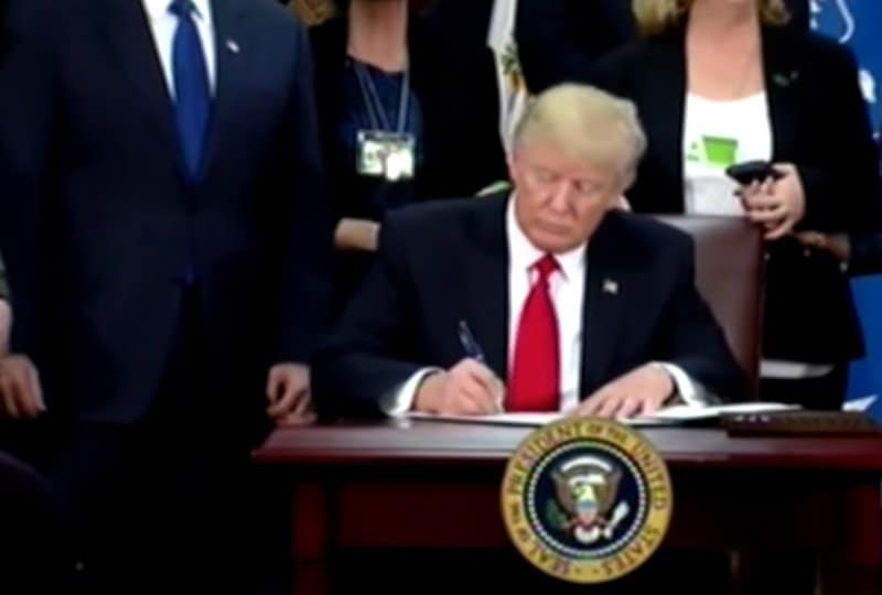Donald Trump signs executive orders.