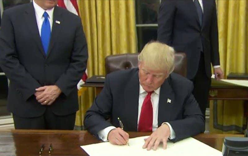 donald trump signs first executive order - towards the repeal of Obamacare.