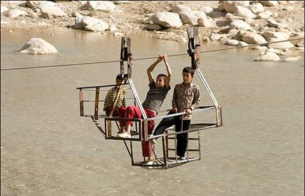 "iran: boys cross river in ""ger ger""."