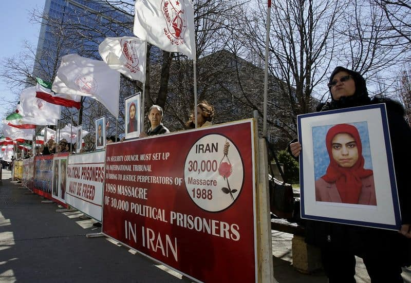"Demonstrators in Ottawa holding banners and placards with slogans ""Stop execution in Iran,"" ""Mullahs leader have to stand trial for crime against humanity."""