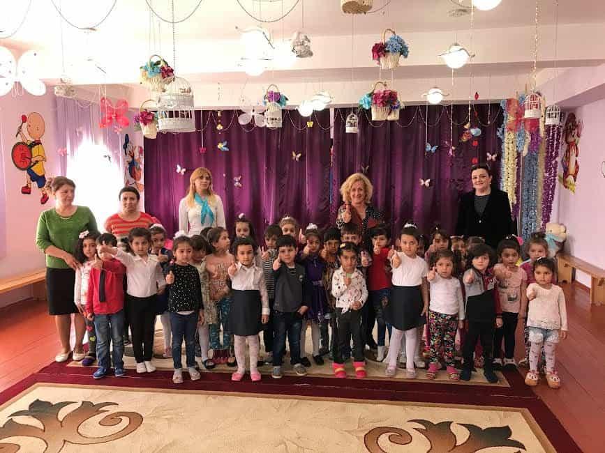 The writer with IDP settlement kindergarten kids.