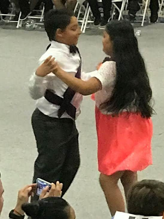 boy and girl dance in competition.
