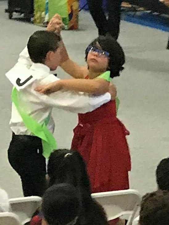 boy and girl dancing.