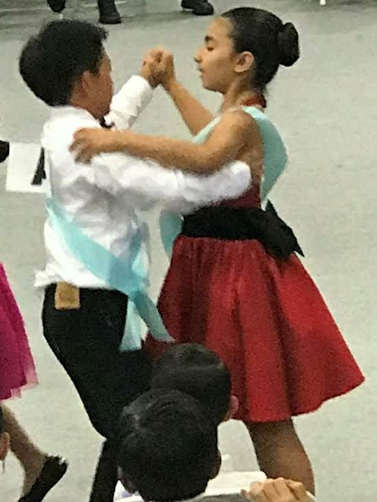 boy and girl waltzing
