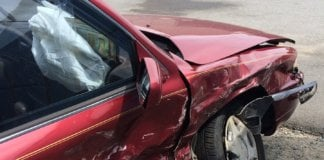 red car after accident.