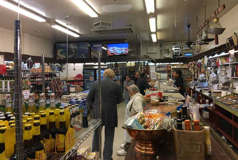 pete allman and papa cristos in the store.