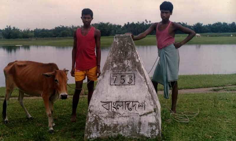 suspected bangladeshi cattle smugglers near international border pillar.