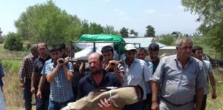 The 18 months old victim's body is carried to be buried by her relatives and fellow villagers on Wednesday, July 5 2017.