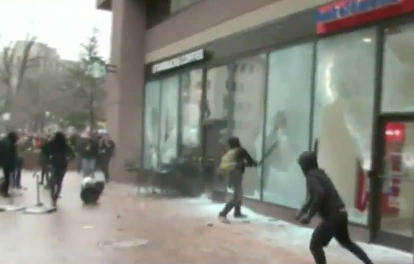 Antifa smashing windows.