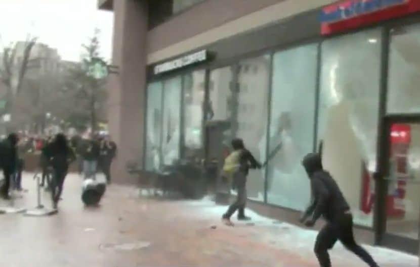 Antifa smashing windows.