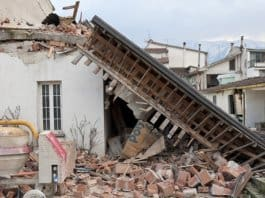 An earthquake destroyed a concrete house in Mexico.