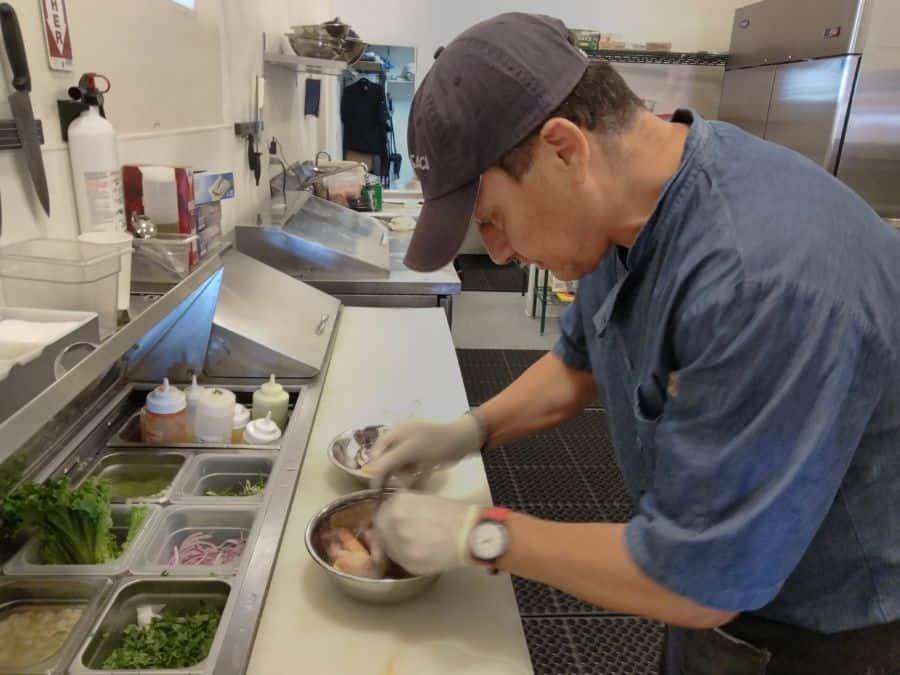 chef gutierrez preparing ceviche de pescado.