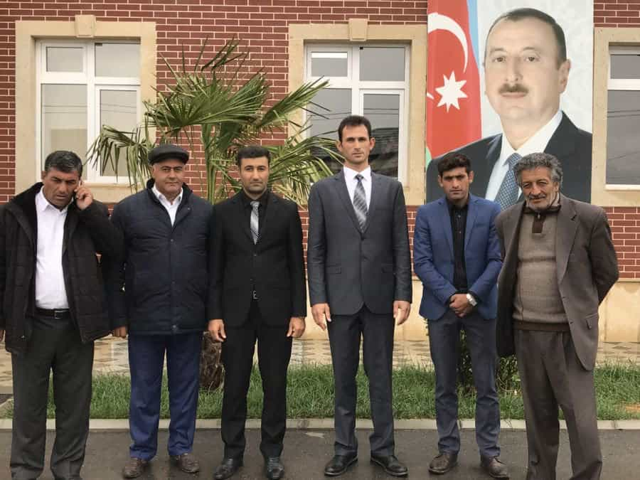 Çocuq Mərcanlı village officials with president Ilham Aliyev poster who gifted them the school.