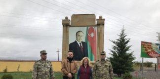 Çocuq Mərcanlı village with military personnel, former president Heydar Aliyev pix in background,