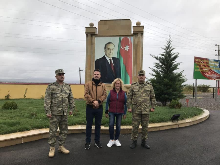 Çocuq Mərcanlı village with military personnel, former president Heydar Aliyev pix in background,