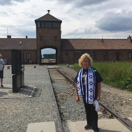 The writer in the entrance to Auschwitz-Birkenau-I am entering what was hell on earth