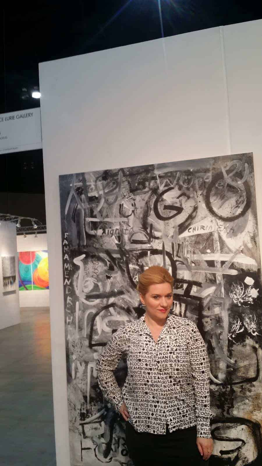 Artist Moira Cue with her work Dignity II, 4'x6', oil on masonite, at the 2018 LA Art Show, Bruce Lurie Gallery booth. Photo: (c). Bruce Edwin 2018.