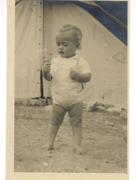 "The writer, one year old, in front of her ""tent home"" in 1948, Israel"