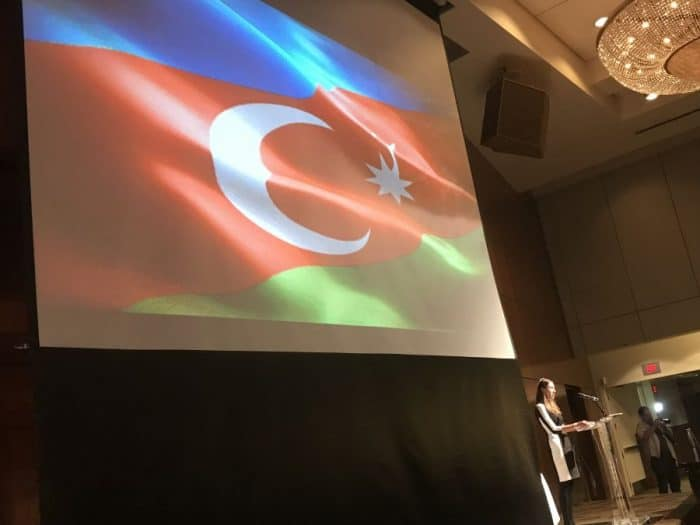 Azerbaijan flag waves at the singing of the country's anthem - at Sinai Temple-AJC-Azerbaijan event-May 14, 2018
