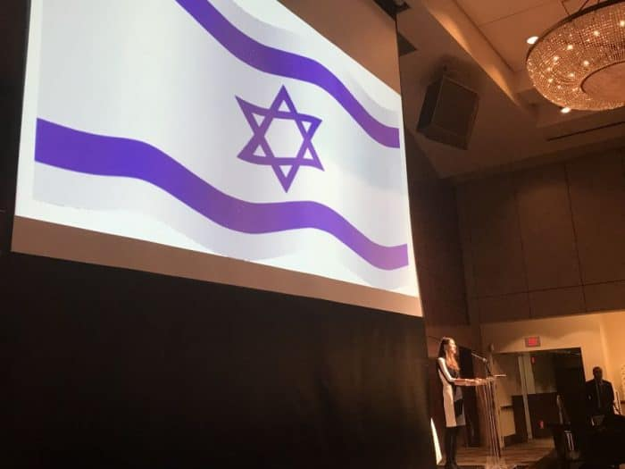 Israel flag waves at the singing of the country's anthem - at Sinai Temple-AJC-Azerbaijan event-May 14, 2018