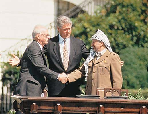 President Clinton oversees Arafat and Rabin infamous handshake on the White House lawn