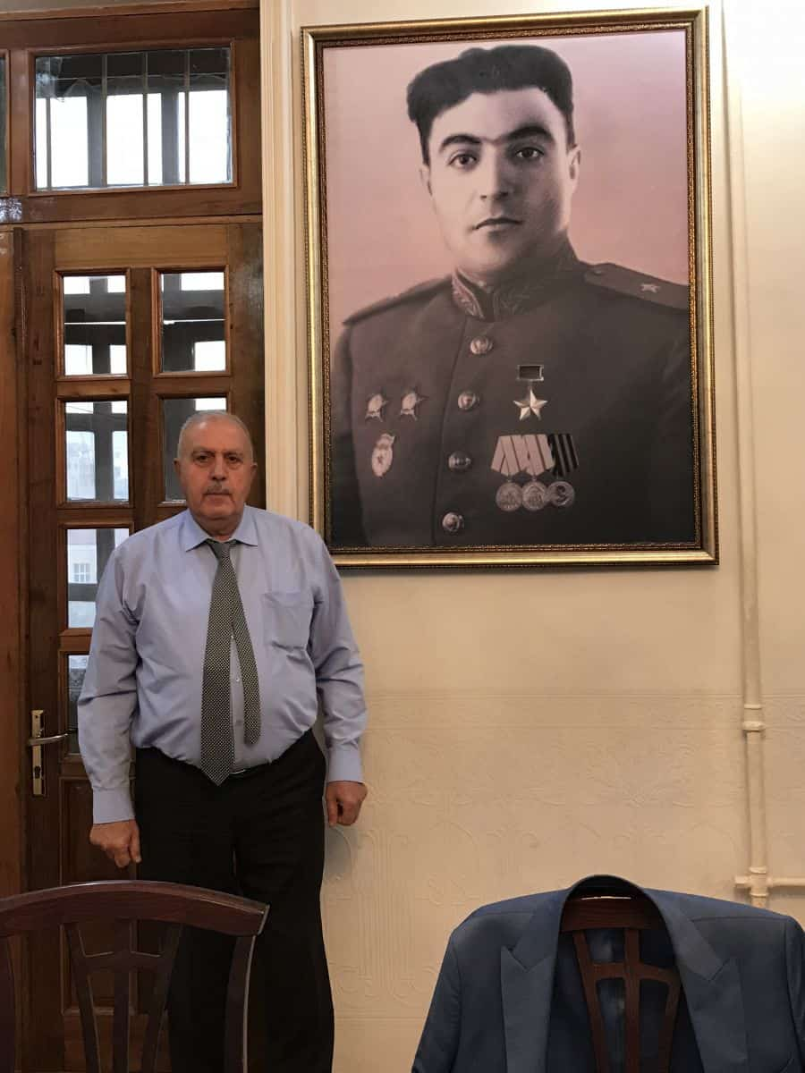 Firdovsi Sadikhov next to his father's photo-Hamza Sadikhov-Sadikhvili