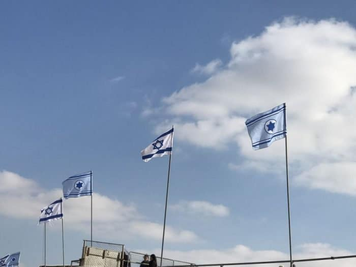 IAF and State of Israel flags on display at the graduation ceremony