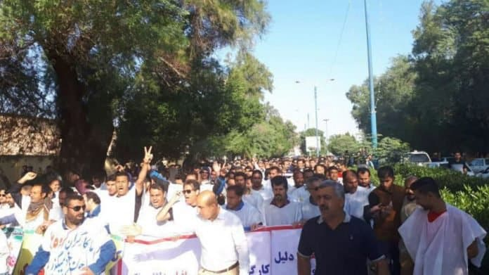 Ahvaz steel workers protest worn the white shirt as a symbol of sacrificing their life.