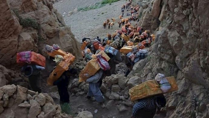 hundreds of back carriers - porters - climb a mountain.